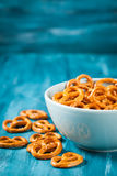 Salty snacks mini pretzels in bowl Stock Photography