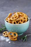 Salty snacks mini pretzels with salt Royalty Free Stock Image