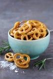 Salty snacks mini pretzels with salt Royalty Free Stock Image