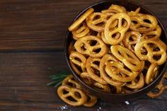Salty snacks mini pretzels with salt Royalty Free Stock Photography