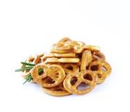 Salty snacks mini pretzels with salt Stock Photos