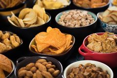 Salty snacks served in bowls Stock Photography