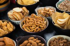 Salty snacks served in bowls Stock Image