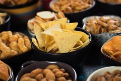 Salty snacks served in bowls Royalty Free Stock Photo