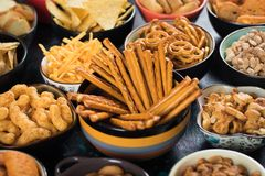 Salty snacks served in bowls Royalty Free Stock Photography