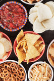 Salty snacks. Tortilla chips and other salty snacks with homemade salsa Royalty Free Stock Photo