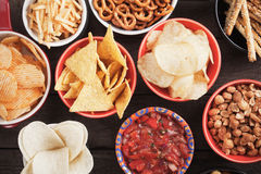 Salty snacks. Tortilla chips and other salty snacks with homemade salsa Royalty Free Stock Photos