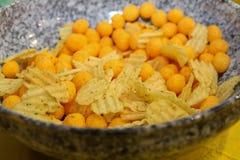 Salty snacks. Unhealthy food Stock Photos
