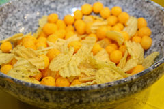 Salty snacks. Unhealthy food Royalty Free Stock Images