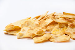 Salty snacks on a white background Stock Images