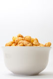 Salty snacks in a white bowl on a white background Royalty Free Stock Photography