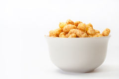 Salty snacks in a white bowl on a white background Royalty Free Stock Photos