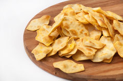 Salty snacks on the wooden kitchen board Stock Image