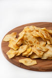 Salty snacks on the wooden kitchen board Stock Photos