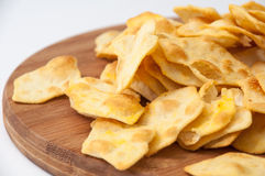 Salty snacks on the wooden kitchen board Royalty Free Stock Photo