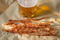 salty spicy fish sticks to beer. tasty beer snack. dried fish. stock photography