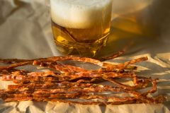 ..salty spicy fish sticks to beer. tasty beer snack. dried fish stock photos