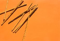 Salty sticks on orange. Background with copy space for text. Top view Stock Photography