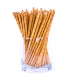 Salty sticks standing in a glass isolated Royalty Free Stock Photos