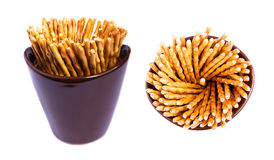 Salty sticks, sticks with poppy seeds. Pretzel - salty sticks or sticks with poppy seeds in cup made in studio isolated on white background - two shots Royalty Free Stock Photo