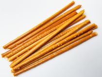 Salty sticks on white background stock photography