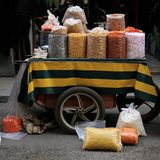 Salty and Sweet Cart. A cart of various salty roasted nuts and sweet snacks in an old souk in Tripoli, Lebanon Stock Image