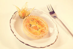 Salty tart on plate Royalty Free Stock Images