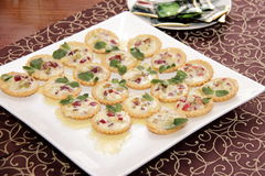 Salty tartlets with cream Royalty Free Stock Photo
