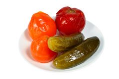 Salty tomatoes and cucumbers Stock Images