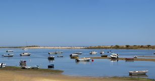 Waterfront Panorama, Salty Water Cove, Summer Holidays, Paradise Algarve. Salty water cove in Cacela Velha, or Old Cacela. The calm water bay is Ria Formosa and Royalty Free Stock Photo