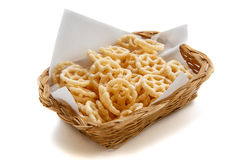 Salty wheels snack in basket on white background, isolated Royalty Free Stock Photos