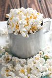 Salty white popcorn in old cup Royalty Free Stock Photos