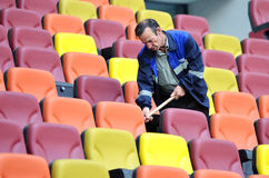 Salubrity worker cleaning football National Arena Stock Photo