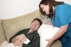 Salud casera - almohadilla de la pelusa imagenes de archivo