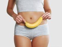 Salud del plátano y de la mujer. Fotos de archivo
