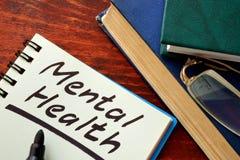 Salud mental escrita en una nota Imágenes de archivo libres de regalías