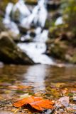 Saluda North Carolina in Autumn with a Fall leaf. Waterfall of Saluda in Autumn showing a different view of seeing waterfalls in the fall royalty free stock image