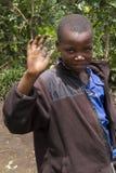 Saludo africano del niño en la cámara Imagen de archivo