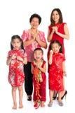 Saludo chino asiático de la familia en Año Nuevo chino Imagenes de archivo