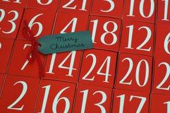 Saludo de Advent Calendar y de la Feliz Navidad Fotografía de archivo libre de regalías