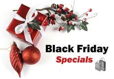 Saludo del mensaje de la venta de Specials de Black Friday con las decoraciones de la Navidad Imágenes de archivo libres de regalías