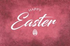 Saludo feliz de Pascua en un fondo rosado Fotos de archivo libres de regalías