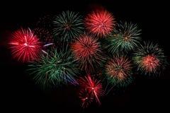 Saludo verde rojo de los fuegos artificiales Imagen de archivo libre de regalías