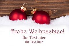 Saludos de la Navidad en la nieve Imágenes de archivo libres de regalías