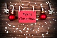 Saludos de la Navidad Nevado Foto de archivo libre de regalías