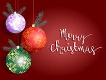 Saludos de las bolas de la Navidad Imágenes de archivo libres de regalías