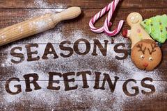 Saludos de las estaciones de las galletas y del texto de la Navidad Foto de archivo