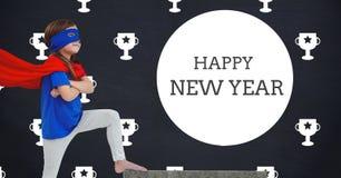 Saludos del Año Nuevo contra una imagen compuesta de la muchacha en traje del super héroe Fotografía de archivo libre de regalías
