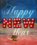 Saludos del Año Nuevo que brillan intensamente sobre la pintura apenada Imágenes de archivo libres de regalías