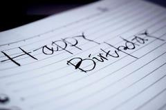 Saludos del cumpleaños en el papel Fotos de archivo